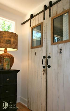 this homeowner rescued two old resort doors and them into her home with the help of classic flat track