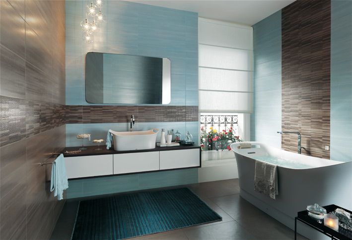 Aqua, browns and whites make this bathroom feels serene and calm
