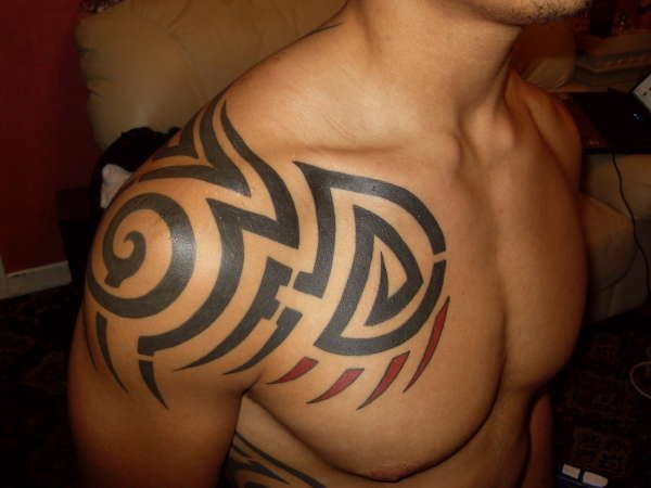 The Most Attractive Feature on a man is the chest .it is the broadest parts of the body. This is why the chest is a perfect place to get a tattoo.chest is the flattest and most open space ,so chest tattoo designs have got much popularity.Men usually go with black patterns of tribal tattoos