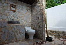 Here you see a bathroom from one of the bungalows at Ayu Hotel Karimunjawa. They are made with natural flat stone, which is quite rare on the Karimunjawa island now, since there was only one place and an old man that digged them out. Anyway, the bathroom is quite nice and there is a cool refreshing open air shower.