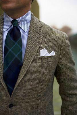 Light grey tweed sport coat, white shirt with blue dress stripes, navy & green plaid tie
