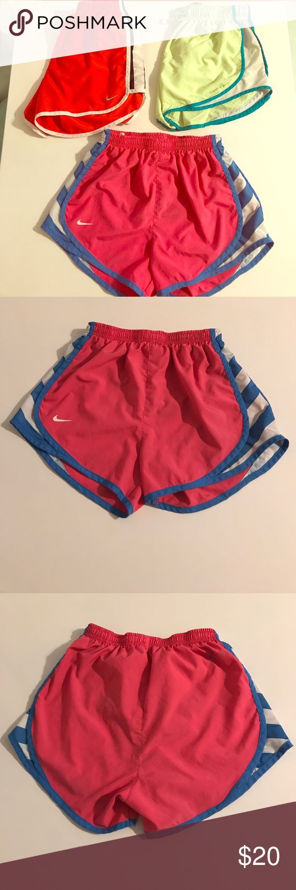 Nike & Calvin Klein running shorts set (xs) 2 Nike and 1 Calvin Klein running shorts set. All xs in size. The pink and fluorescent lime green shorts have spots on them but it is not very visible when worn. It just looks like shadow spots. Nike Pants Track Pants & Joggers