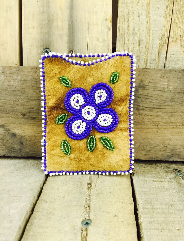 Moose-hide cardholder with blue and white beaded flower and trim #Esawa #Cardholder #Handmade #Flower