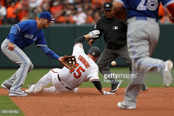 News Photo : Mark Trumbo of the Baltimore Orioles slides into...