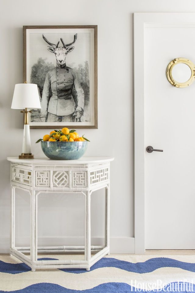 In designer Benjamin Dhong's house in California's wine country, a surreal print from CB2 greets you in the entryway. A Signature lamp from Currey and Company sits atop a Chinese table, another flea-market purchase that Dhong painted white. The walls are painted in Benjamin Moore's Light Pewter.