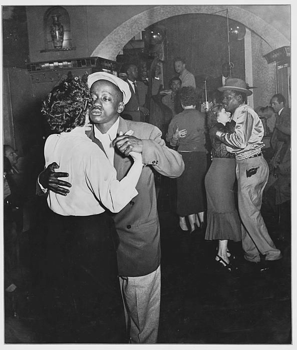 1950's. Dancing at the Casablanca on the Zeedijk in Amsterdam. At Cassablanca black jazz musicians performed and black men danced with white women. Dancing Casablanca became a legend in a short period of time. It was the club of saxophonist Kid Dynamite and trumpeter Teddy Cotton. Gerry Mulligan, Count Basie and Erroll Garner also played there. The jazz club still exists today. Photo Jan Peeterse #amsterdam #1950