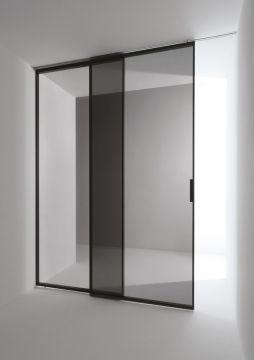 Minimal sliding door designed by Antonio Citterio for Tre-Piu _