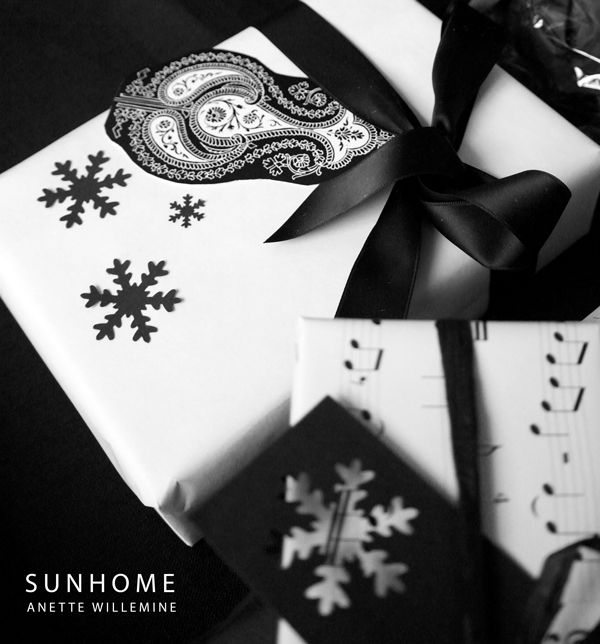 Plain white paper left over from a printing company stamped with black snowflakes.