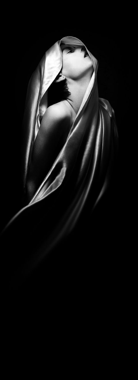 Beautiful lighting and exceptional use of low-key negative space. A lovely image. wrapped up in a satin sheet