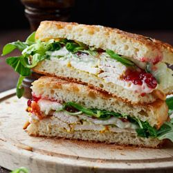focaccia,turkey, cranberry,white cheese, and sth green like rucola