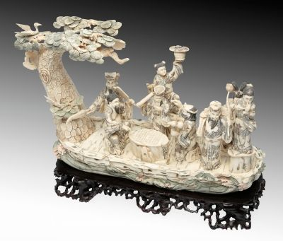 """Auction Lot: 35004593. Chinese School, mid-20th century. """"Eight Taoist Immortals"""". Carved and polychrome bone. Wooden base. 31 x 47.5 x 17 cm, 5.6 x 44.5 x 16 cm (base)."""