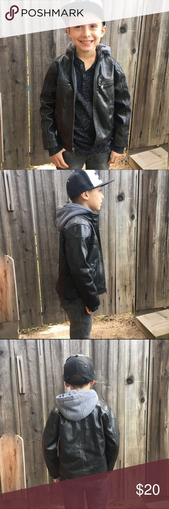 Boys leather jacket Leather jacket in great condition. Has built-in gray hood. The jacket is black but has hints of brown around the edges. Urban Republic Jackets & Coats