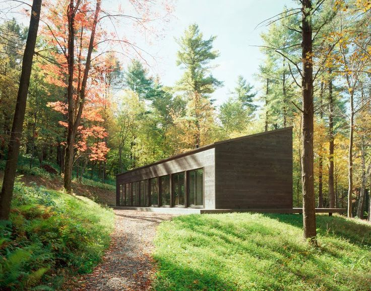 """Sixteen Doors House was constructed by Incorporated Architecture & Design and is located in Hillsdale, New York. The home seems to bring in a bit of the surrounding woodland indoors, with a warm color palette reminiscent of the 70s, wooden floors, tiny ceramic forest animals and antlers, and even a small potted tree.            Sixteen Doors House by Incorporated Architecture & Design: """"This is the first of three residences in rural Upstate New York that emerged from the study of the…"""