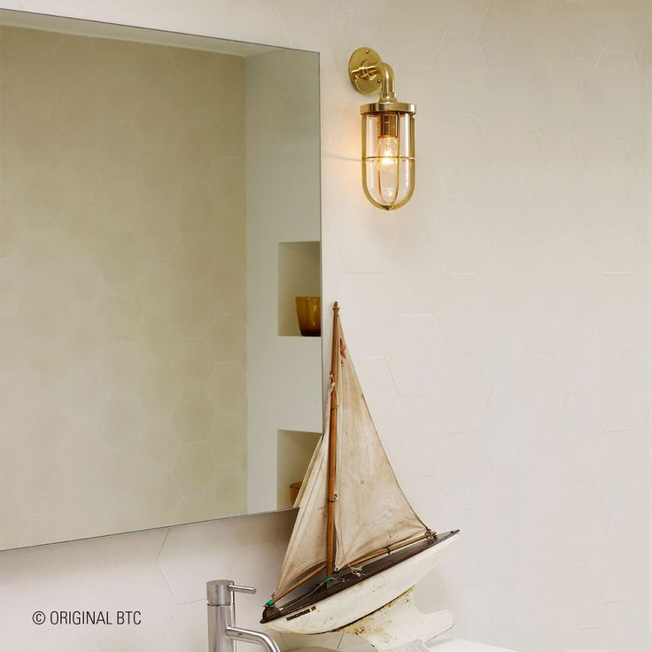 Need waterproof lighting for your bathroom? Take a look at our Ship's Well collection. Available in frosted or clear glass and encased in a chrome, polished or weathered brass guard.