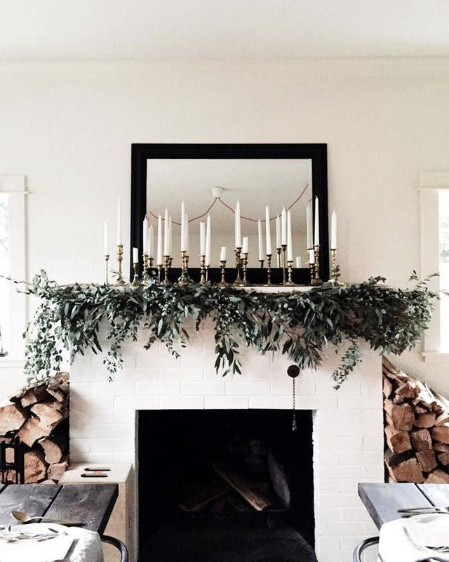 14 Beautiful Ideas for a Minimalist Christmas | Christmas decorations don't have to be flashy or over the top, these sleek and streamlined ideas are more metallic accents white ornaments and plenty of fir and evergreen plants.