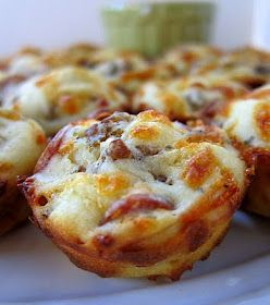 Sausage & Pepperoni Pizza Puffs  3/4 cup flour  3/4 tsp baking powder  1/2 tsp garlic powder  3/4 cup whole milk  1 egg, lightly beaten  4 oz mozzarella cheese, shredded (about 1 cup)  2 oz mini turkey pepperoni, (about 1/2 cup)  4 oz low-fat sausage, cooked and crumbled  1/2 cup pizza sauce