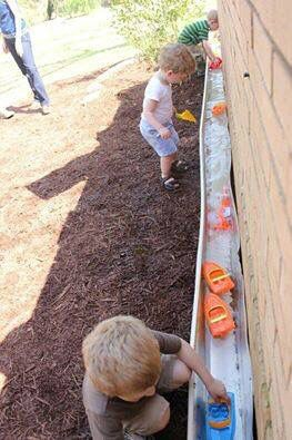 Flip a rain gutter over and make a river for the kids!