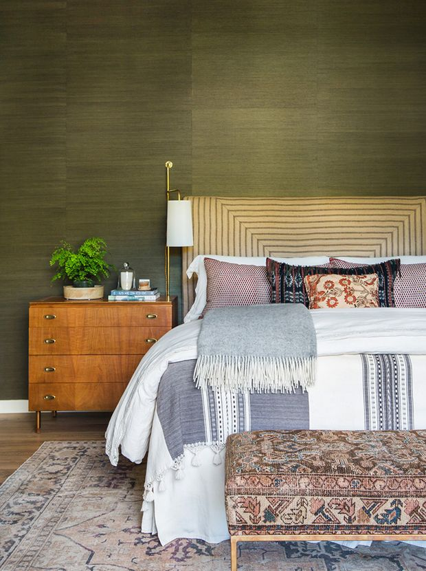 Green gold wallpaper brings depth to this layered