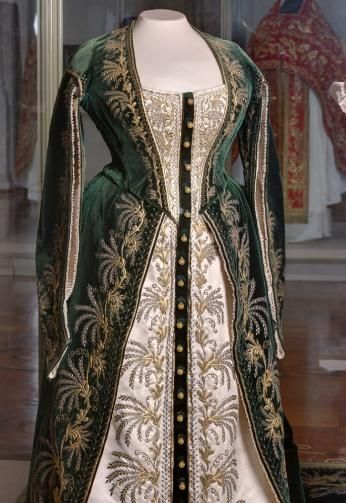 Court dress in ceremonial Mistress Russia, St. Petersburg. The end of the XIX century. Workshop O. Bulbenkovoy velvet, satin, metal, metallic thread, sequins, beat; gold embroidery Leaf: 52.0 back length; Skirt length 169.0; trail length 270.0 On the ribbon corsage stamp printed in gold workshop: Ms. OLGA DRESS St. Peterburg Wash Post number 8. in 1941 of the GME; earlier: the palace Yusupov Inv. EFV number 13147-a-b