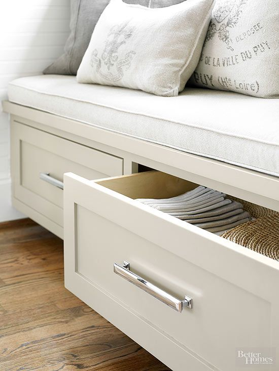 You don't have to sacrifice design in a tight space. This cozy banquette offers integrated storage for table linens in its two full-depth drawers.