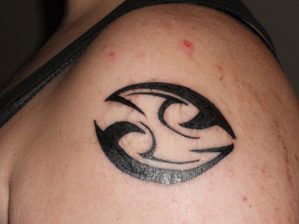 Black Ink Tribal Cancer Tattoo On Shoulder