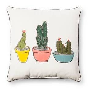 Potted cacti print combines with embroidered spines in the Cream Throw Pillow Cactus from Room Essentials. This cactus accent pillow adds a bit of whimsy to any room.