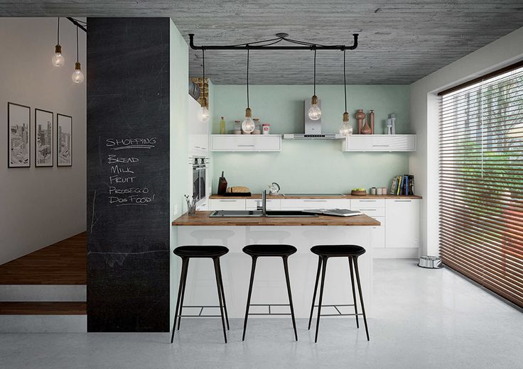 This contemporary urban kitchen is small but functional. And we love the blackboard wall idea!