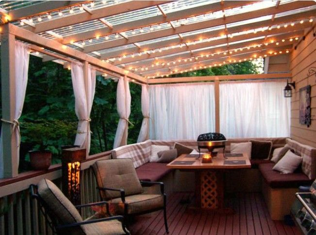 bedroom balcony with twinkle lights and cream-colored water-resistant sheer panels