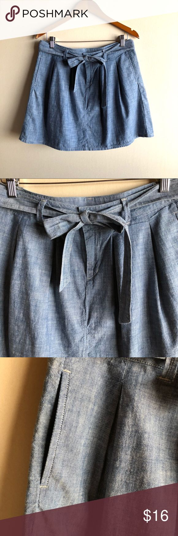"Gap chambray full skirt with pockets Adorable chambray skirt by GAP with a removable tie at the waist. Pleated. Front pockets. Measures 16"" across waist and 18"" long. Above knee length. 100% cotton. Excellent condition! GAP Skirts A-Line or Full"