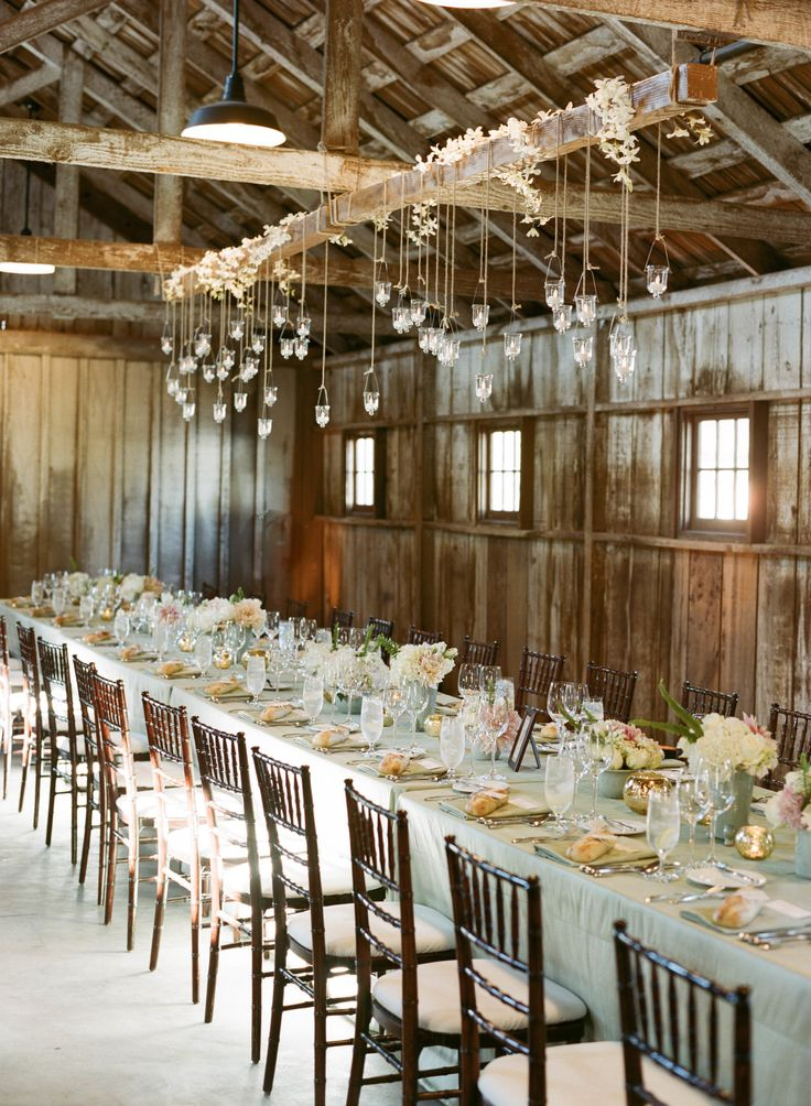 used a wood beam to hang lighting over table.Photography: Sylvie Gil Photography - sylviegilphotography.com  Read More: http://www.stylemepretty.com/2014/01/29/california-wedding-at-santa-lucia-preserve/