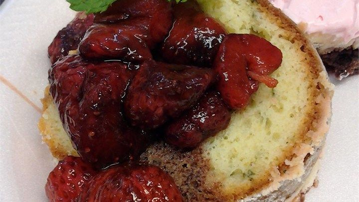 A rich white cake baked in a fluted tube pan has the beguiling flavor of sweet basil. The cake is served with fresh strawberries in balsamic syrup for an unusual and fresh springtime dessert.