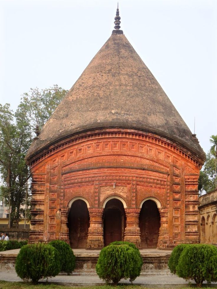 The Anika Ttemple at Puthia, Bangladesh, features an egg-shaped roof and fine decoration.