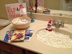 LOVE this idea for the first morning of the return of the Elf, swimming in a sink of mini marshmallows (bubble bath) and a bowl of powdered donuts for breakfast with a little treat for the kids, and of course the Elf on a Shelf book to read!