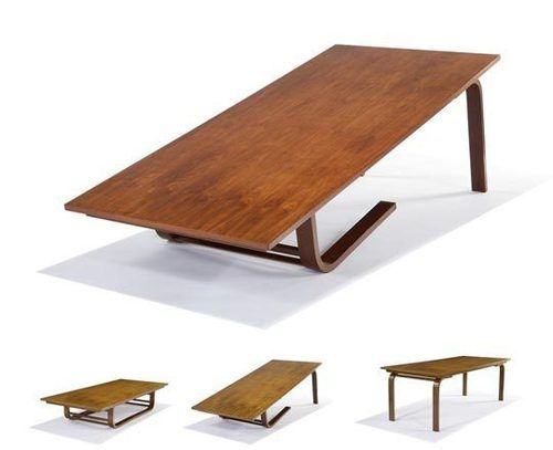 Richard Neutra designed Camel Table for Moore House, Ojai in 1952 converts from coffee table height to dining table height (the moniker refe...