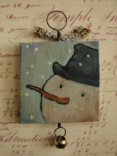 by Julie Mathews  ~New Christmas Ornaments~ I like how she has added the hand-twisted  hooks, the fabric bow and the jingle bell.