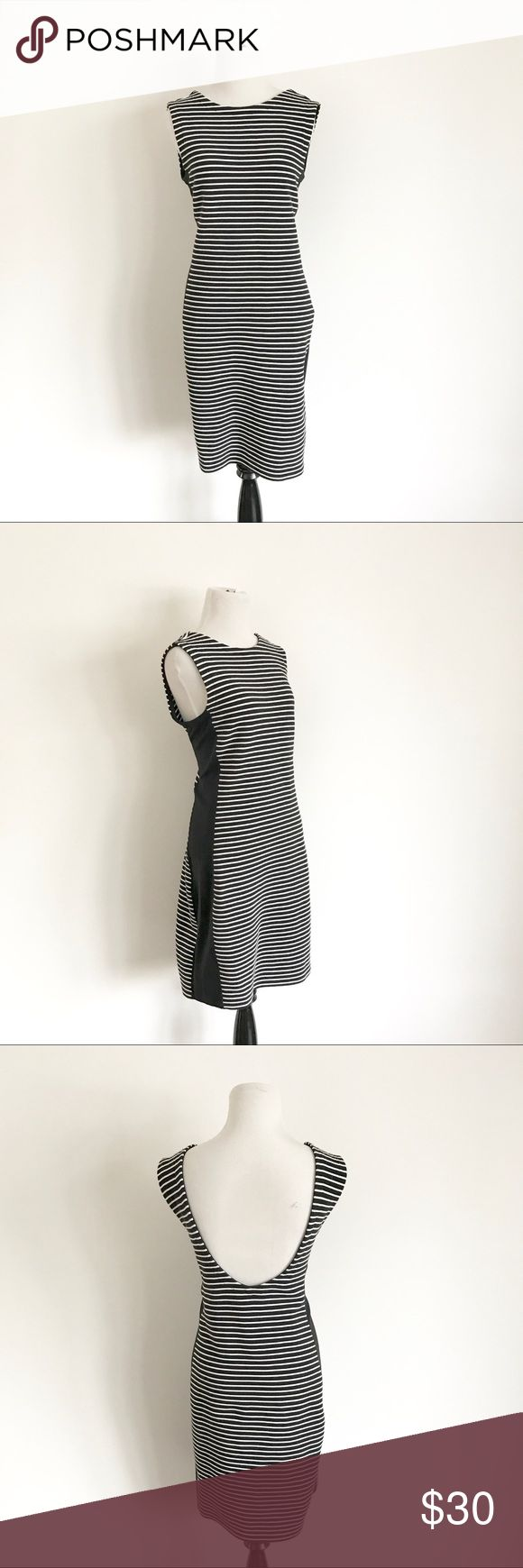 Athleta Striped Bodycon Dress Black and white striped fitted bodycon dress from Athleta. Thick fabric, great quality, super flattering on! Athleta Dresses