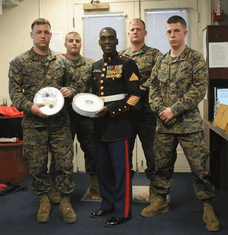 We the Marines of Marine Barracks Washington Ceremonial Honor Guard wish to thank all of the Soldiers Angels who constantly think of us. We extend our hearts to you and your Angel network. Thank you for the delicious cake. We are forwarding a photo of the Marines in the S-3 Operations Section who work so hard ensuring that all of our ceremonies are flawless, thank you once again. Pictured in the dress uniform is Gunnery Sergeant William J. Dixon, the Marine Corps Funeral Director.