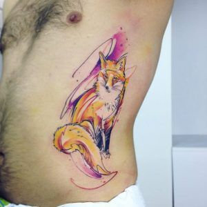 Gorgeous watercolor fox tattoo on rib cage by Adrian Bascur