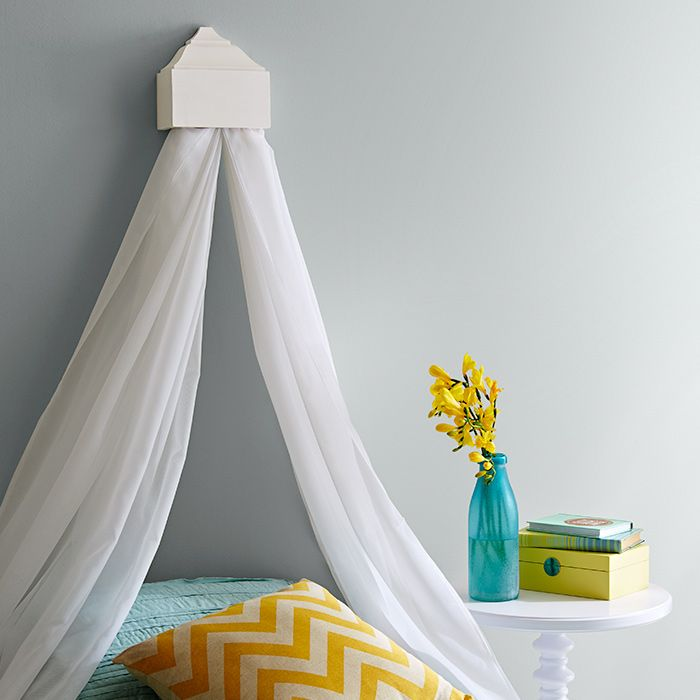 Drape your bed in gauzy fabric for a soft alternative to a for Hanging canopy over bed