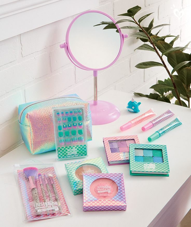Our Just Shine Limited Edition Mermaid at Heart collection includes shimmer powder, eyeshadow, lip gloss, nail tips and more.