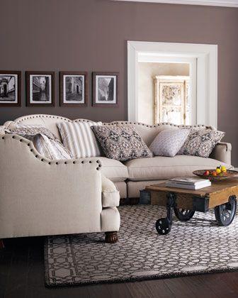 greige walls, white, dark wood floor, cool couch