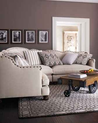 greige walls, white, dark wood floor, cool couch