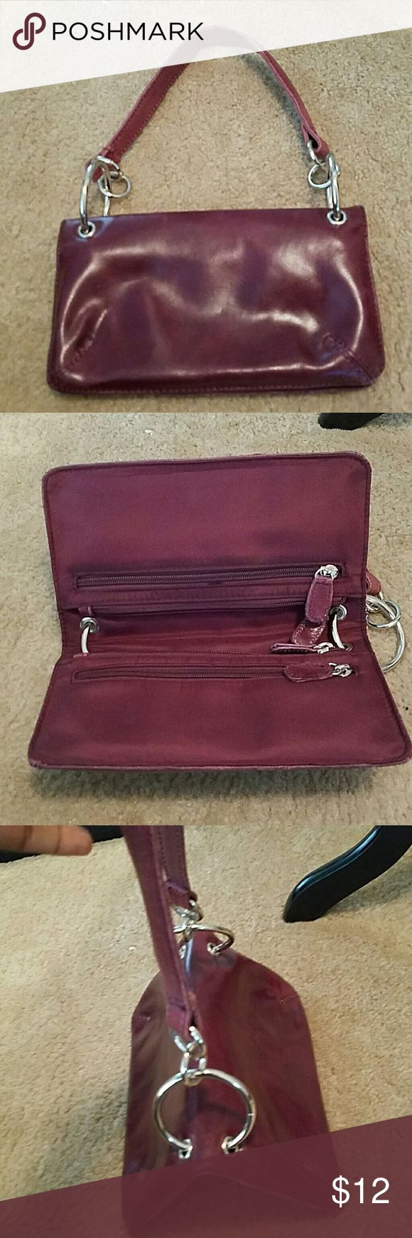 WILSON'S LEATHER Small Handbag Pre owned but in great condition. Burgundy. The leather strap does show more wear. Wilsons Leather Bags Clutches & Wristlets