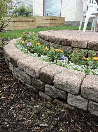 Planter in bottom half of retaining wall.