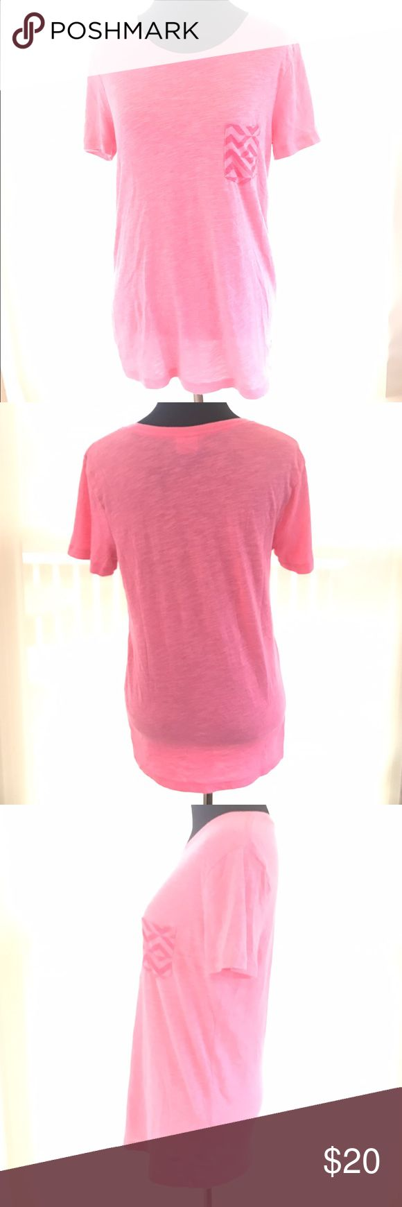 PINK VICTORIAS SECRET CHEVRON POCKET T SHIRT SZ XS Super cute good condition pink Victoria's Secret shirt sleeve orange pink color t shirt. Cute chevron accent pocket in front. Size XS PINK Victoria's Secret Tops Tees - Short Sleeve