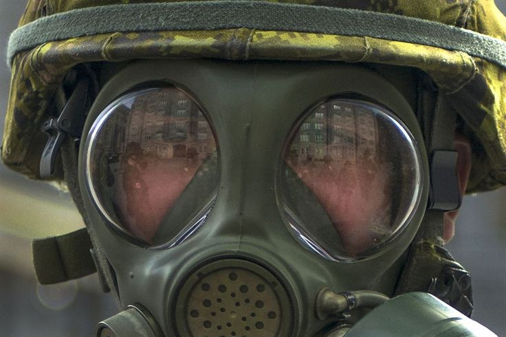 Cadets practice donning their chemical protective gear before participating in the 2016 Sandhurst competition at the U.S. Military Academy, West Point, N.Y., April 7, 2016. The cadets are assigned to the Canadian Royal Military Academy. Army photo by Sgt. 1st Class Brian Hamilton
