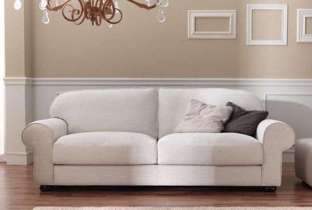 Elegante y sofisticado sofá en tela blanco de dos plazas