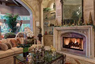 Mediterranean Living Room with High ceiling, limestone tile floors, Pendant Light, interior wallpaper, Built-in bookshelf