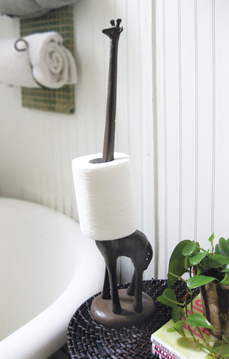 Cast iron giraffe paper towel, jewelry, toilet paper holder - would be great for my bath, as it's also the guest bath (travel theme.)