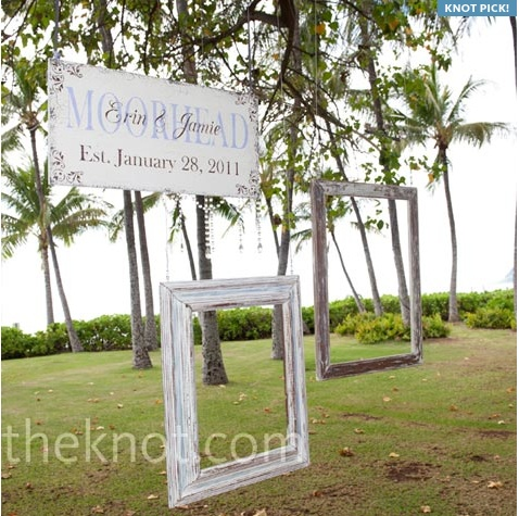 empty photoframes as part of the decor for an outside wedding